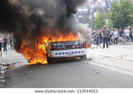 TORONTO-JUNE 26:  Police cars burning during the G20 Protest on June 26, 2010 in Toronto, Canada.