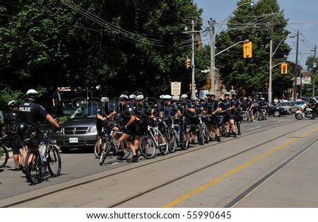 TORONTO-JUNE 25: Police with bicycles getting ready to folloe protesters at G20 protest on June 25, 2010 in Toronto, Canada.