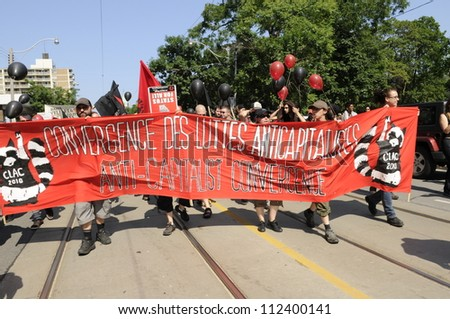 TORONTO-JUNE 25:   Protesters carrying anti capitalist banners during the G20 Protest on June 25, 2010 in Toronto, Canada.