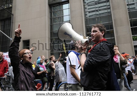 TORONTO-JUNE 26:  Protesters chanting slogans on a microphone in downtown  during the G20 Protest on June 26 2010 in Toronto, Canada.