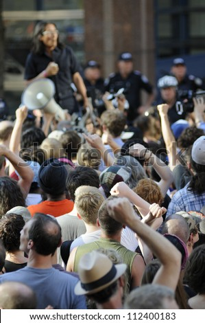TORONTO-JUNE 28:   Protesters raising their hands as a mark of solidarity during a protest rally in front of the police headquarter after the G20 summit on June 28, 2010 in Toronto, Canada.