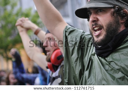 TORONTO-JUNE 26:   Protesters shouting and yelling against the police officers who didn't allow them to enter the summit area during the G20 Protest on June 26 2010 in Toronto, Canada. - stock photo