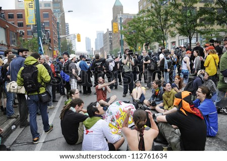 TORONTO-JUNE 26: Protesters sitting on the streets as a mark of protest after being not allowed to enter the perimeter of the event during the G20 Protest on June 26 2010 in Toronto, Canada.
