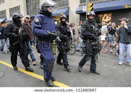 TORONTO-JUNE 26:  Riot police marching  the streets during the G20 Protest on June 26, 2010 in Toronto, Canada. - stock photo