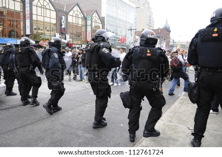 TORONTO-JUNE 26:   Riot police officers approaching the protesters during the G20 Protest on June 26 2010 in Toronto, Canada.