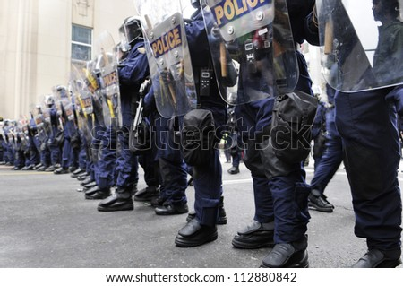 TORONTO-JUNE 26:  Riot police officers forming a barricade during the G20 Protest on June 26, 2010 in Toronto, Canada. - stock photo