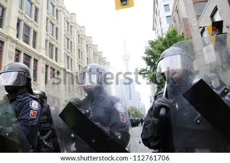 TORONTO-JUNE 26:   Riot police officers protecting the main event venue during the G20 Protest on June 26 2010 in Toronto, Canada. - stock photo