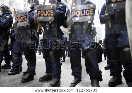 TORONTO-JUNE 26:   Riot police officers with their riot gears during the G20 Protest on June 26 2010 in Toronto, Canada.