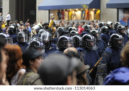 TORONTO-JUNE 26: Riot police restricting protesters during the G20 Protest on June 26, 2010 in Toronto, Canada.
