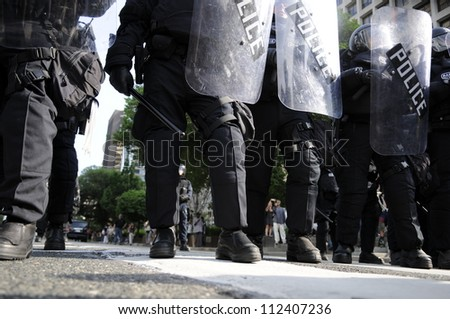 TORONTO-JUNE 25:  Riot police stepping ahead of the protesters  during the G20 Protest on June 25, 2010 in Toronto, Canada.