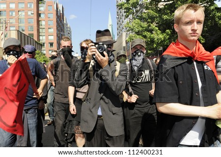 TORONTO-JUNE 25:   The black anarchist group who was later accused of vandalizing shops and store  during the G20 Protest on June 25, 2010 in Toronto, Canada.