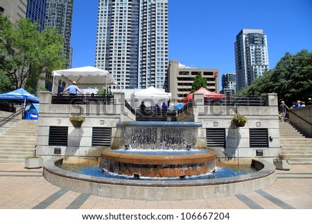 TORONTO - JUNE 13: The North York Centre and Mel Lastman Square on June 13, 2012 in Toronto. The square features 20,000 square feet of outdoor space and is named for former Toronto mayor Mel Lastman. - stock photo