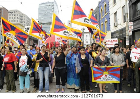 TORONTO-JUNE 26:   Tibetan- Canadians marching in a rally to raise their voices against their own issue during the G20 Protest on June 26 2010 in Toronto, Canada. - stock photo