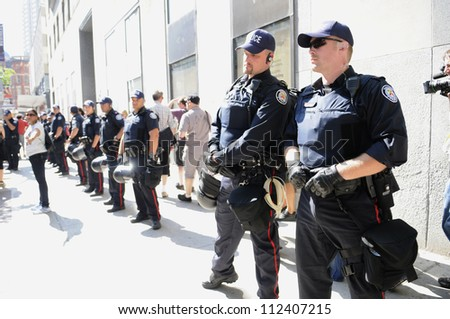 TORONTO-JUNE 25:  Toronto police forming a perimeter during the G20 Protest on June 25, 2010 in Toronto, Canada.
