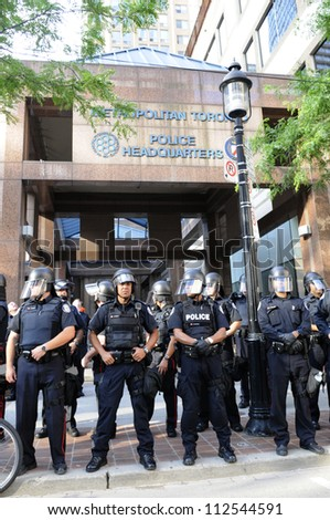 TORONTO-JUNE 28: Toronto police in front of their headquarter during  a rally to protest against the mass G20 arrest on June 28, 2010 in Toronto, Canada.