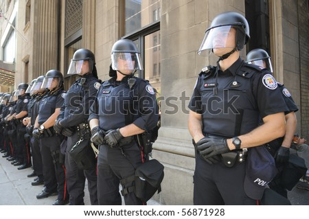 TORONTO-JUNE 25:  Toronto Police officers in riot gear line up  during the G20 Protest on June 25, 2010 in Toronto, Canada.
