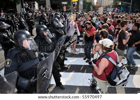 TORONTO-JUNE 25: Toronto Riot Police restrict protesters movement away from G20 Summit at Convention Centre  on June 25, 2010 in Toronto, Canada.