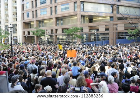 TORONTO-JUNE 28:  Torontonians  gather outside the police headquarters  to protest against the mass arrest a day before during the G20 Protest on June 28, 2010 in Toronto, Canada.