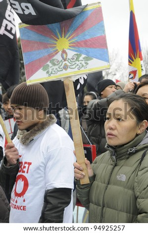 TORONTO - MARCH 10:  Grim looking marching in a rally organized to protest against the Chinese occupation of Tibet on March 10 2009 in Toronto, Canada.