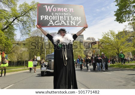 TORONTO- MAY 5: A Marijuana activist showing a sign which congratulates women in ending marijuana prohibition in Canada during the 14th annual Global Marijuana March on May 5  2012 in Toronto, Canada.