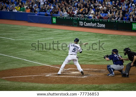 TORONTO - MAY 19: Toronto Blue Jays' player Yunel Escobar at bat during a MLB game against the Tampa Bay Rays at Rogers Centre on May 19, 2011 in Toronto. Toronto won 3-2.
