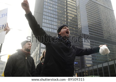TORONTO - NOVEMBER 24: An angry occupy Toronto protester chanting slogans in downtown Toronto during a occupy movement rally on November 24, 2011 in Toronto, Canada.