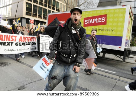 "TORONTO - NOVEMBER 24:  An angry protester chanting slogans during a ""occupy movement rally in Downtown Toronto on November 24, 2011 in Toronto, Canada."