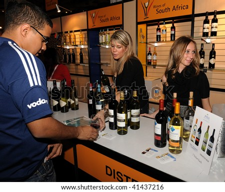 TORONTO-NOVEMBER 21: At the 15th Annual Gourmet Food and Wine Expo, held from Nov.19-22, there were over 1500 wines,beers and spirits from around the World on November 21, 2009 in Toronto, Canada - stock photo