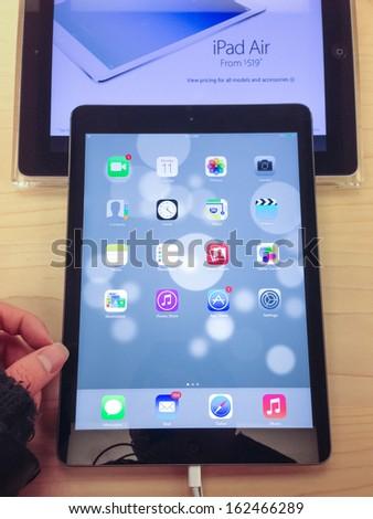 TORONTO - NOVEMBER 11: Custormer tries the iPad Air at the Apple Store in Toronto, Canada on November 11, 2013. - stock photo