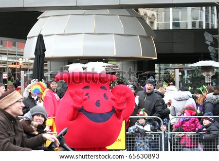 TORONTO - NOVEMBER 21: Onlookers watch floats on Front Street at Toronto's 106th annual Santa Claus Parade on November 21, 2010 in Toronto, Canada.