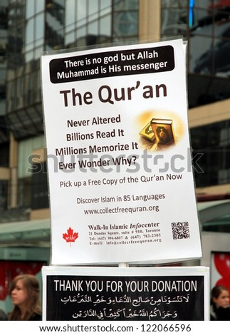 TORONTO - NOVEMBER 23: Pro Quran sign on November 23, 2012 in Toronto. With about 1.8 billion followers or 26% of earth's population, Islam is the second-largest religion in the world.
