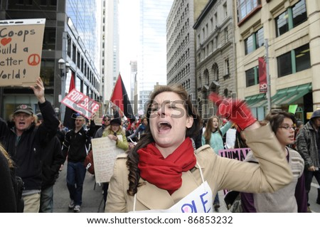 TORONTO - OCTOBER 17: Angry protestor chanting slogans while participating in a rally   during the Occupy Toronto Movement on October 17, 2011 in Toronto, Canada.