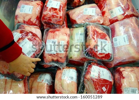TORONTO - OCTOBER 13: Packaged beef in a supermarket on October 13, 2013 in Toronto. Beef is the third most widely consumed meat in the world, accounting for about 25% of meat production worldwide.