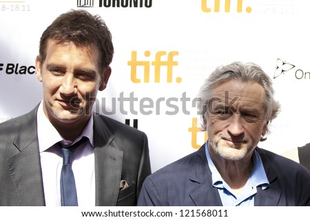 "TORONTO, ON/CANADA - SEPTEMBER 10, 2011: Actors Clive Owen, Robert De Niro pose at the gala for the film ""Killer Elite"" during the Toronto International Film Festival  on September 10, 2011 in Toronto"