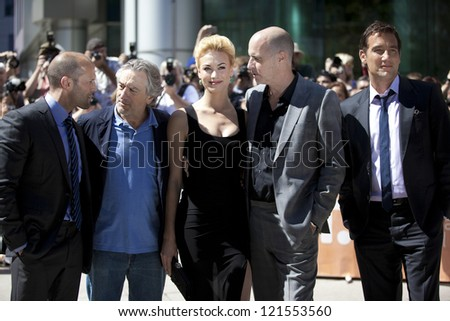 "TORONTO, ON/CANADA - SEPTEMBER 10, 2011:  Actors Jason Statham, Robert De Niro, Yvonne Strahovski, and Clive Owen pose at the gala for the film ""Killer Elite"" on September 10, 2011 in Toronto"
