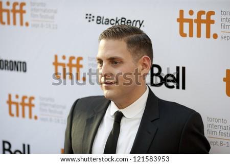 TORONTO, ON/CANADA - SEPTEMBER 9, 2011:  Jonah Hill steps onto the red carpet at the 2011 Toronto International Film Festival for the screening of Moneyball on September 9, 2011 in Toronto