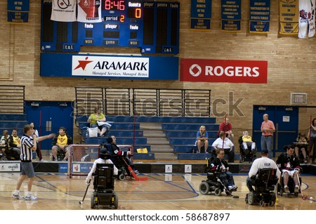 TORONTO, ONTARIO - AUGUST 7: Disabled athletes of Ottawa Capitals team against Minnesota Stars during the Power Hockey Cup on August 7, 2010 at Ryerson University in Toronto, Ontario, Canada