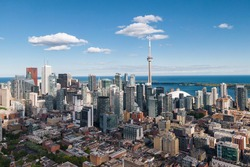Toronto, Ontario, Canada, daytime aerial view of Toronto cityscape including architectural landmark CN Tower and modern high rise buildings in the financial district.