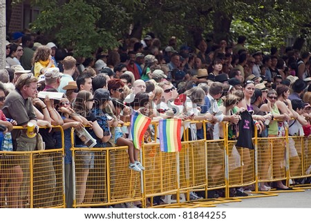 TORONTO, ONTARIO, CANADA - JULY 3: Crowd of observers at the 2011 Annual Gay Pride Parade in Toronto on July 3, 2011.