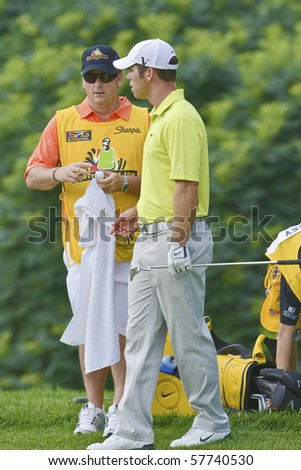 TORONTO, ONTARIO - JULY 21:English golfer Paul Casey andf his caddy during a pro-am event at the RBC Canadian Open golf on July 21, 2010 on Toronto, Ontario.