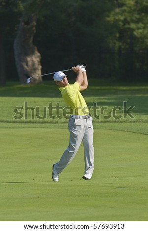 TORONTO, ONTARIO - JULY 21:English golfer Paul Casey hits to a green during a pro-am event at the RBC Canadian Open golf on July 21, 2010 in Toronto, Ontario.