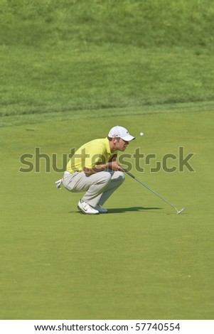 TORONTO, ONTARIO - JULY 21:English golfer Paul Casey lines up a putt during a pro-am event at the RBC Canadian Open golf on July 21, 2010 on Toronto, Ontario.