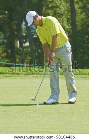 TORONTO, ONTARIO - JULY 21 : English golfer Paul Casey putts during a pro-am event at the RBC Canadian Open golf on July 21, 2010 in Toronto, Ontario