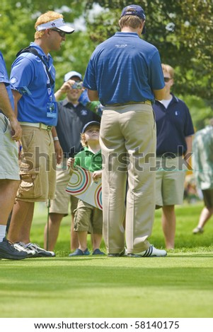 TORONTO, ONTARIO - JULY 21 : South African golfer Retief Goosen signs autograph for a little boy during a pro-am event at the RBC Canadian Open golf on July 21, 2010 in Toronto.
