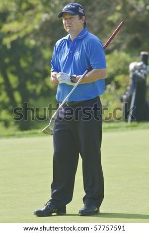 TORONTO, ONTARIO - JULY 21: South African golfer Tim Clark prepares to putt during a pro-am event at the RBC Canadian Open golf on July 21, 2010.