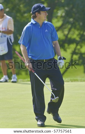 TORONTO, ONTARIO - JULY 21: South African golfer Tim Clark walks on a green during a pro-am event at the RBC Canadian Open golf on July 21, 2010.