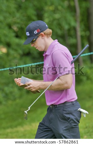 TORONTO, ONTARIO - JULY 21: U.S. golfer Hunter Mahan makes notes as he exits a green during a pro-am event at the RBC Canadian Open golf on July 21, 2010 in Toronto, Ontario