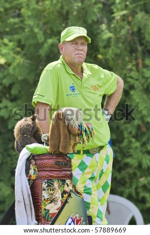 TORONTO, ONTARIO - JULY 21: US golfer John Daly waiting for his turn during a pro-am event at the RBC Canadian Open golf  St. George's; Golf and Country Club; July 21, 2010 in Toronto, Ontario.