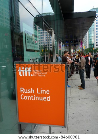 TORONTO - SEPTEMBER 13: People gather for rush line at the TIFF Bell Lightbox hours before film screening for the 36th Toronto International Film Festival Sept 13, 2011 in Toronto, Canada