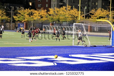 TORONTO - SEPTEMBER 29: The Varsity Stadium during a night time soccer game on September 29, 2012 in Toronto. Football is played by over 250 million players in over 200 countries. - stock photo